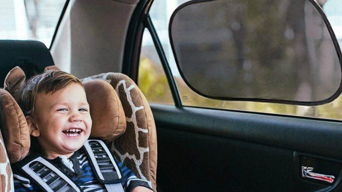 Baby laughing in the car shade
