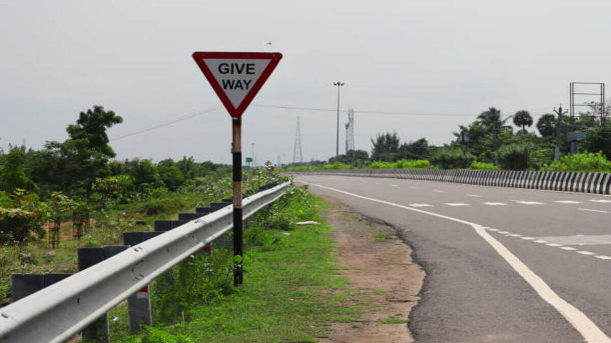 Image depicting a traffic sign on a road